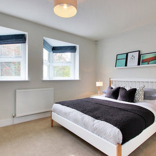 Design ideas for a scandinavian guest bedroom in Kent with white walls and carpet.