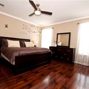 Mid-sized transitional master dark wood floor and brown floor bedroom photo in Orlando with beige walls
