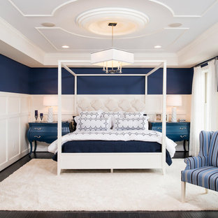Classic master bedroom in DC Metro with multi-coloured walls and dark hardwood flooring.