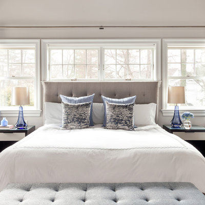 Inspiration for a transitional master dark wood floor bedroom remodel in New York with beige walls