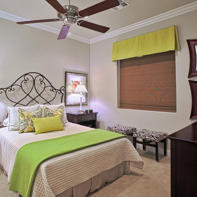 Example of a trendy carpeted bedroom design in Nashville with beige walls