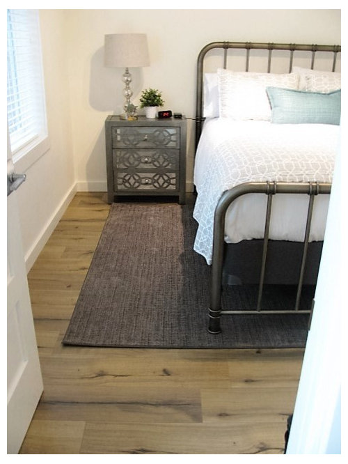 Mid Sized Elegant Guest Laminate Floor And Brown Floor Bedroom Photo In  Portland With White