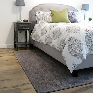 Inspiration for a mid-sized timeless guest laminate floor and brown floor bedroom remodel in Portland with white walls and no fireplace
