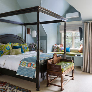 Inspiration for an eclectic carpeted bedroom remodel in Denver with blue walls
