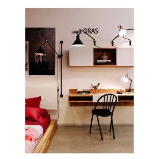 Imagen de habitación de invitados minimalista, pequeña, con paredes blancas y suelo de cemento