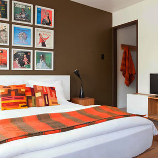 Inspiration for a mid-sized guest bedroom in Los Angeles with brown walls, terra-cotta floors and no fireplace.