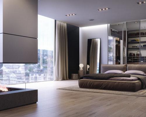 Camera da letto moderna con camino bifacciale foto e idee per arredare - Camera da letto con camino ...