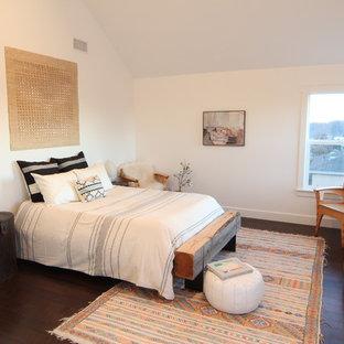 Eclectic dark wood floor bedroom photo in Los Angeles with white walls