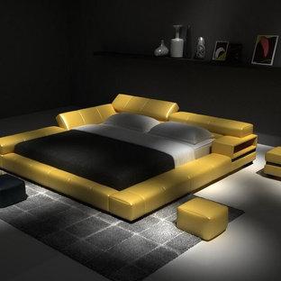 Modelo de habitación de invitados contemporánea, de tamaño medio, sin chimenea, con paredes negras, suelo de cemento y suelo gris
