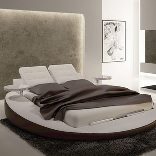 Inspiration for a large modern master bedroom in Toronto with white walls, marble floors, no fireplace and beige floor.