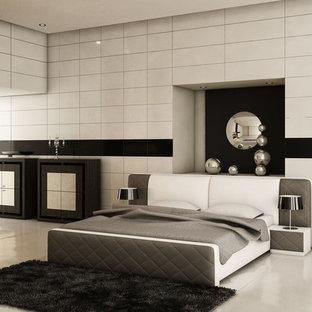 Foto de dormitorio principal, moderno, grande, con paredes blancas, chimenea tradicional, marco de chimenea de metal, suelo de cemento y suelo gris