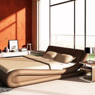 Large modern master bedroom in Toronto with orange walls, no fireplace, beige floor and light hardwood floors.
