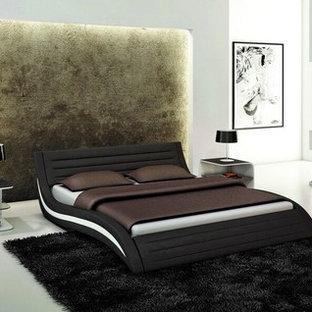 Foto de dormitorio principal, moderno, de tamaño medio, sin chimenea, con paredes blancas, suelo de cemento y suelo gris