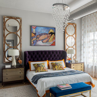 Bedroom - mid-sized eclectic master medium tone wood floor and beige floor bedroom idea in Boston with no fireplace and gray walls