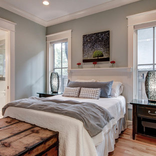 Inspiration for a contemporary master light wood floor bedroom remodel in Nashville with gray walls and no fireplace