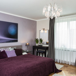 Trendy Medium Tone Wood Floor Bedroom Photo In Other With Purple Walls