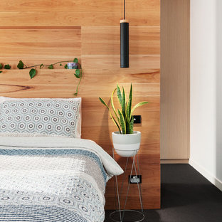 Design ideas for a contemporary bedroom in Melbourne with white walls, carpet, no fireplace and black floor.