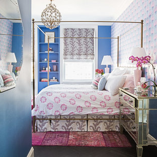 Mid-sized eclectic black floor bedroom photo in New York with multicolored walls