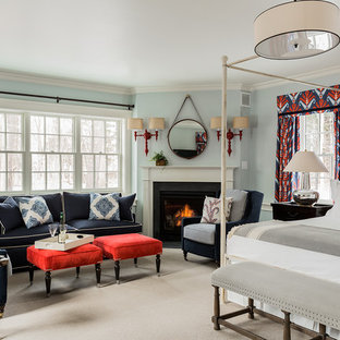 Mid-sized trendy master carpeted and beige floor bedroom photo in Boston with blue walls, a corner fireplace and a wood fireplace surround