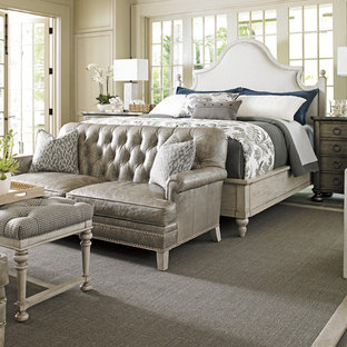 Design ideas for a large shabby-chic style master bedroom in Charleston with white walls, slate floors and no fireplace.