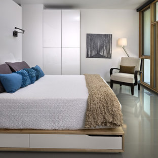 Example of a minimalist bedroom design in Edmonton with white walls