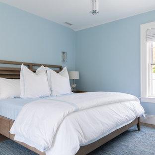 Bedroom - beach style guest medium tone wood floor and beige floor bedroom idea in Boston with blue walls