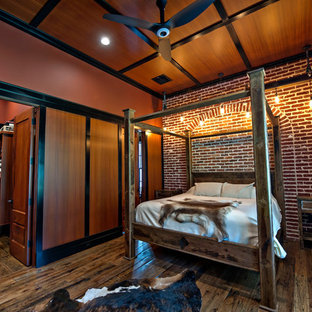Bedroom - craftsman master dark wood floor bedroom idea in Atlanta with brown walls