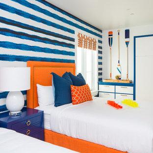 Bedroom - beach style guest light wood floor and beige floor bedroom idea in Orange County with multicolored walls