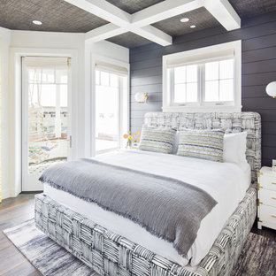 Inspiration for a mid-sized coastal master medium tone wood floor and brown floor bedroom remodel in Orange County with black walls