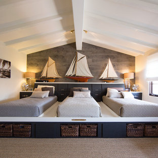 Example of a beach style carpeted bedroom design in Orange County with white walls
