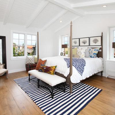 Bedroom - coastal medium tone wood floor bedroom idea in Orange County with white walls and no fireplace