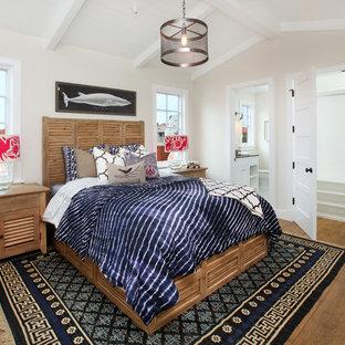 Example of a coastal bedroom design in Orange County with beige walls