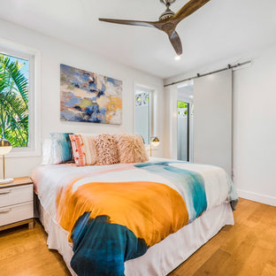 1950s Medium Tone Wood Floor Bedroom Photo In Tampa With White Walls