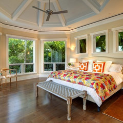 tropical bedroom by Clifford M. Scholz Architects Inc.