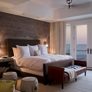 Inspiration for a mid-sized beach style master bedroom in Baltimore with brown walls.