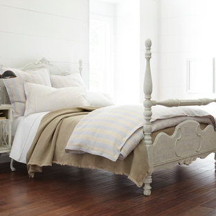 Inspiration for a mid-sized traditional bedroom in Other with white walls and dark hardwood floors.
