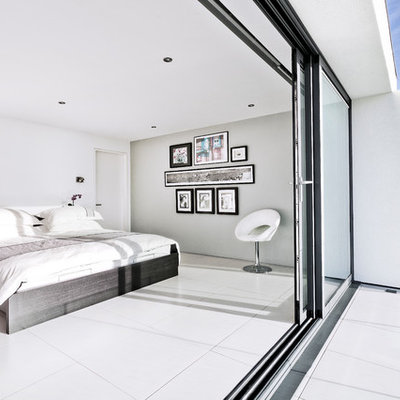 Trendy white floor bedroom photo in Hampshire with gray walls