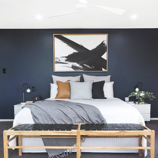 Photo of a contemporary master bedroom in Other with black walls, carpet and grey floor.