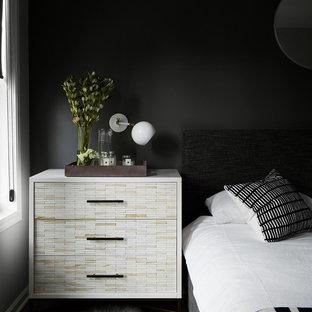 Ejemplo de dormitorio principal, minimalista, de tamaño medio, sin chimenea, con paredes grises, suelo de madera oscura, marco de chimenea de baldosas y/o azulejos y suelo negro