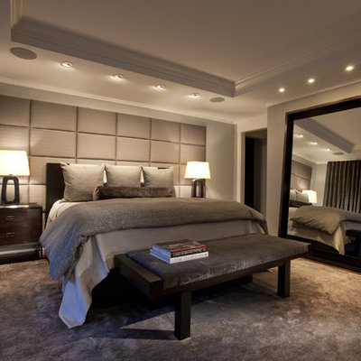 Example of a classic master dark wood floor bedroom design in Chicago with gray walls
