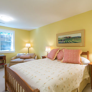 Design ideas for a mid-sized traditional guest bedroom in Other with yellow walls, carpet, no fireplace and beige floor.
