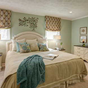 This is an example of a large traditional master bedroom in Richmond with green walls, carpet and no fireplace.