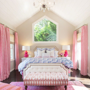 Example of a large classic master dark wood floor bedroom design in Los Angeles with beige walls