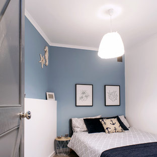 Bedroom - small beach style guest linoleum floor and gray floor bedroom idea in Other with blue walls and no fireplace