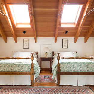 Inspiration for a craftsman guest medium tone wood floor bedroom remodel in Portland Maine with white walls