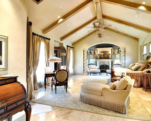 inspiration for a large victorian master travertine floor bedroom remodel in dallas with beige walls