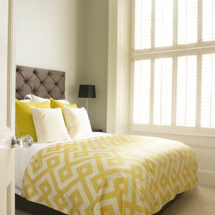 Inspiration for a small contemporary guest bedroom in London with grey walls and carpet.