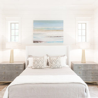 Inspiration for a beach style master light wood floor and beige floor bedroom remodel in Miami with white walls and no fireplace