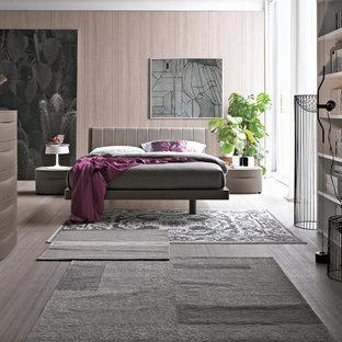 Idee per una camera matrimoniale minimalista di medie dimensioni con pareti rosa, parquet chiaro e pavimento grigio