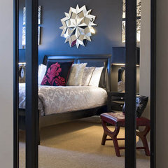 modern bedroom by Decorating Den Interiors